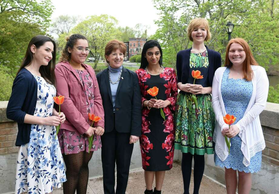 Mayor Kathy Sheehan smiles for a photo with the five finalists for the 2019 Albany Tulip Queen on Wednesday, May 1, 2019 at the Washington Park Lakehouse in Albany, NY. The finalists from left to right are Emily Barcia-Varno, 22, of Glenmont; Isabella Burnett, 19, of Albany; Parneet Kaur, 19, of Green Island; Megan Morrill, 23, of Latham; and Michaela Schramm, 18, of Loudonville. (Phoebe Sheehan/Times Union) Photo: Phoebe Sheehan, Albany Times Union / 20046819A