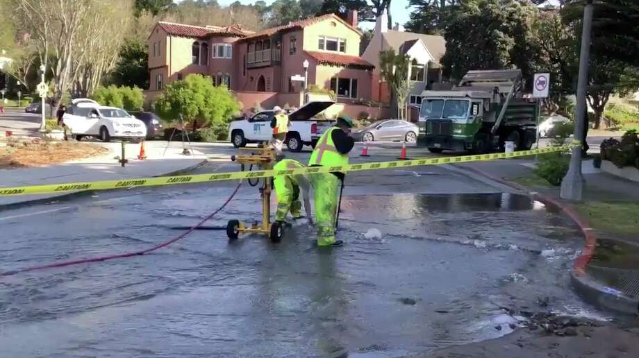 SFPUC workers repair a water main break at the Dewey traffic circle in San Francisco on May 1, 2019. Photo: SFPUC