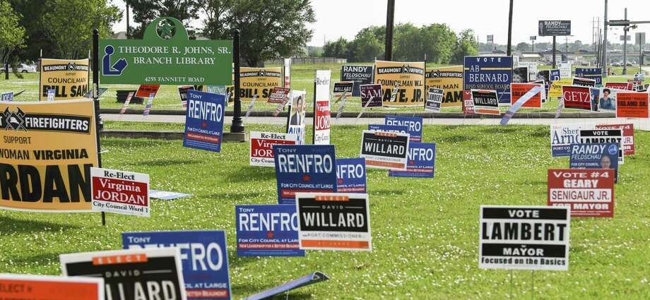 Signs line the road outside of Theodore R. Johns, Sr. Branch Library Tuesday as people vote early in the area's elections. Photo taken on Tuesday, 04/3019. Ryan Welch/The Enterprise Photo: Ryan Welch, Beuamont Enterprise / The Enterprise / © 2019 Beaumont Enterprise