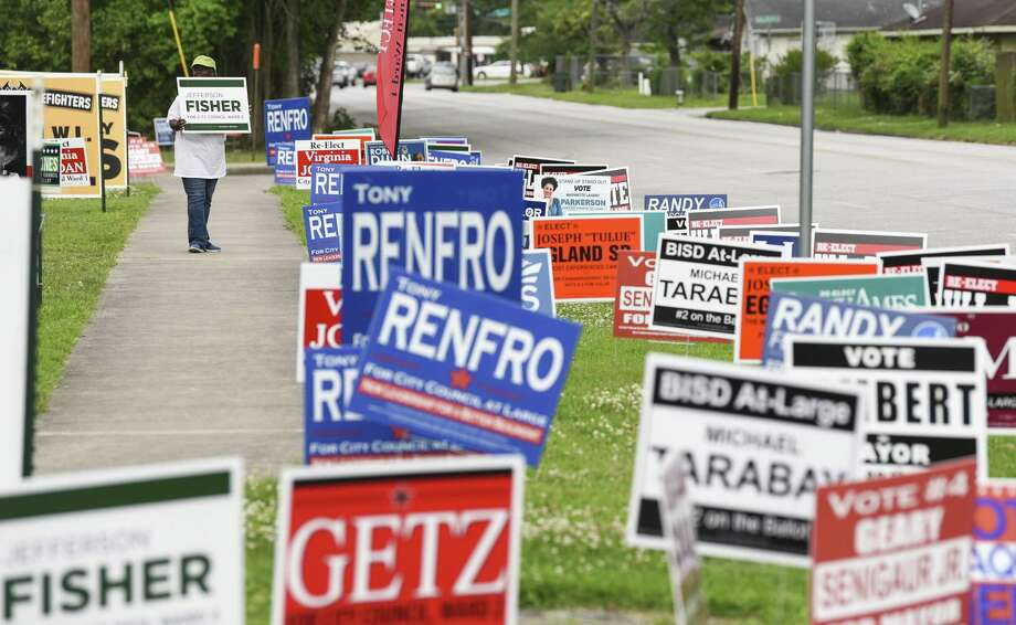 Signs line the road outside of Judge John Paul Davis Community Center Tuesday as people vote early in the area's elections. Photo taken on Tuesday, 04/3019. Ryan Welch/The Enterprise Photo: Ryan Welch / Ryan Welch / The Enterprise / © 2019 Beaumont Enterprise
