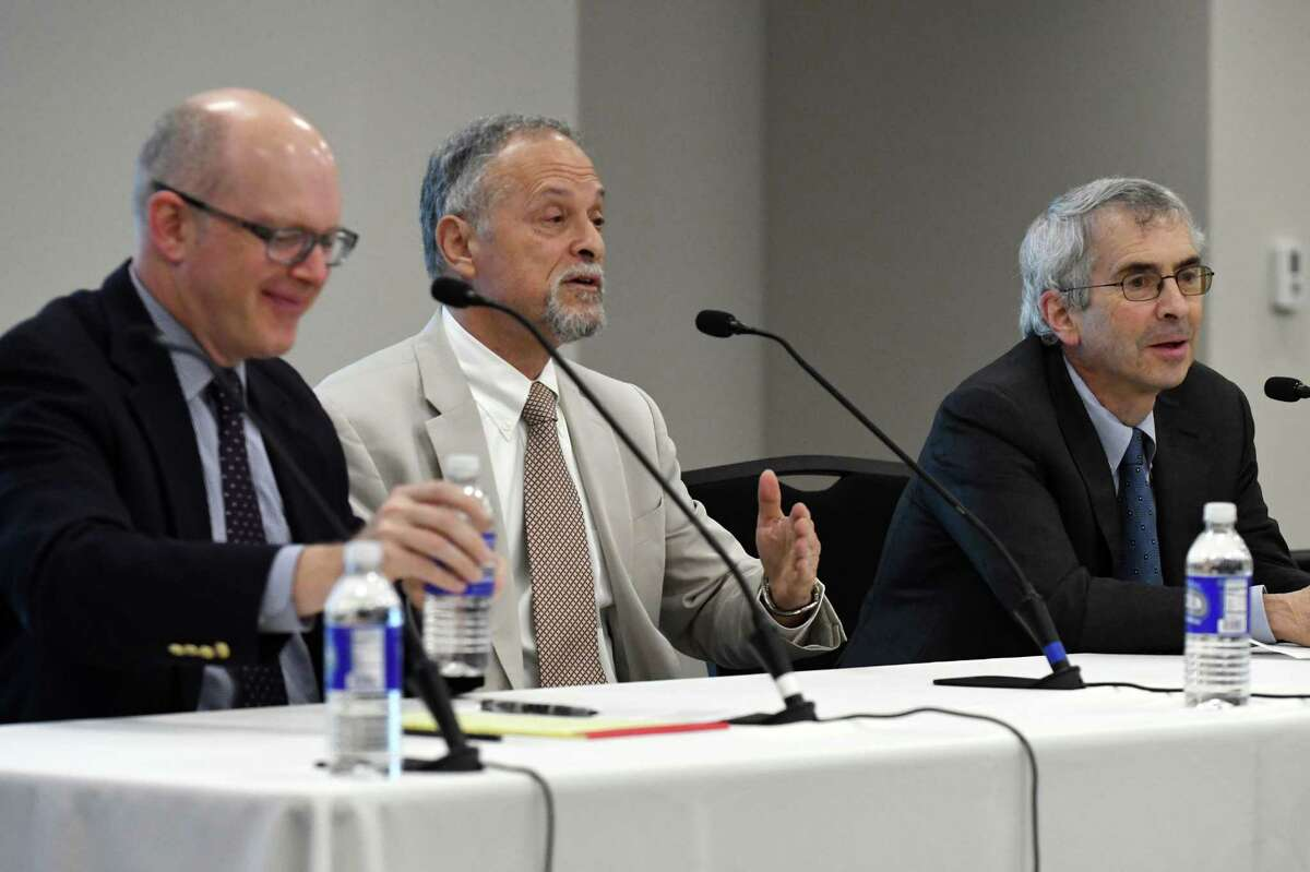 Daniel Feldman, John Jay College of Criminal Justice, center, and Richard Briffault, New York City Conflicts of Interest Board, right, take part in an symposium on ethics reform moderated by Casey Seiler, Times Union managing editor, left, on Wednesday, May 1, 2019, at the Hearst Media Center in Colonie, N.Y. (Will Waldron/Times Union)