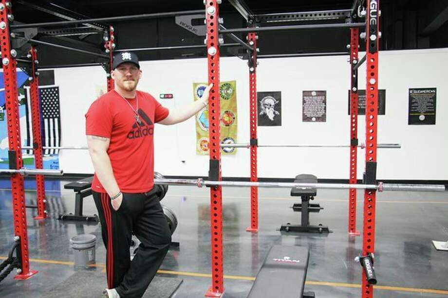 Fred Morrish, owner of Maximum Effort Training Compound, poses near a squat rack on Wednesday, which was opening day for his new gym. The gym is located at 950 N. Van Dyke Road in Bad Axe. (Robert Creenan/Huron Daily Tribune)