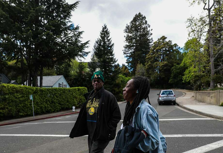 Greg Dunston, 61, and his partner Marie Mckinzie, 53, walk back home after visiting Hampton Park, in Piedmont. The pair, formerly homeless, moved into a basement apartment in Piedmont three months ago. Photo: Yalonda M. James / The Chronicle