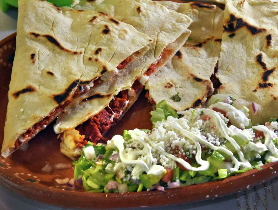 Marinated pork quesadilla at Oaxaquena Triqui restaurant Friday May 5, 2017 in Albany, NY.  (John Carl D'Annibale / Times Union) Photo: John Carl D'Annibale / 20040430A