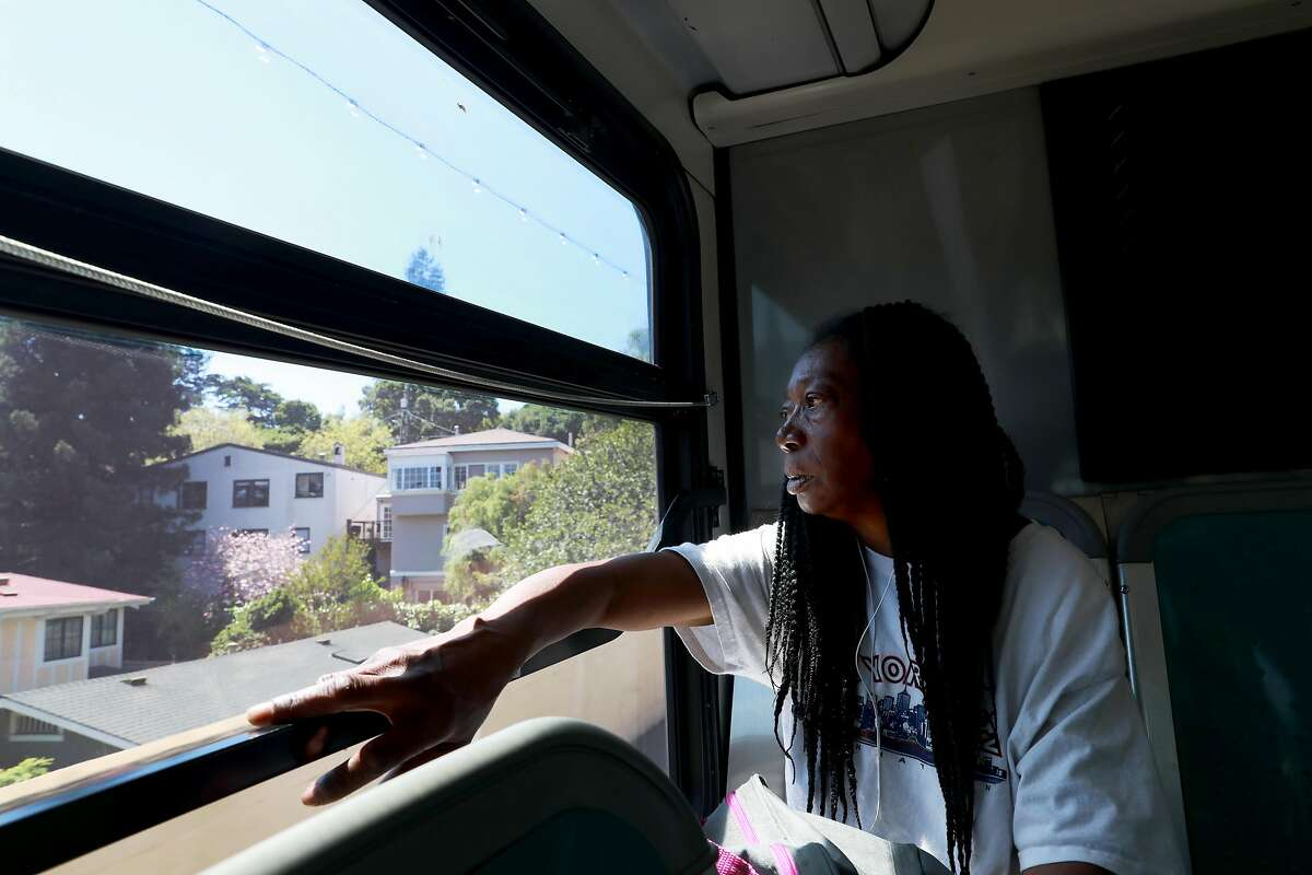 Marie Mckinzie, 54, stares at houses as she makes her way home in Piedmont, Calif., on Wednesday, April 24, 2019. Her partner Greg Dunston, Sr., 61, left Marie on the bus to grab pizza from a 7-Eleven convenience store on Harrison St., after she told him she didn't plan to cook dinner that night.