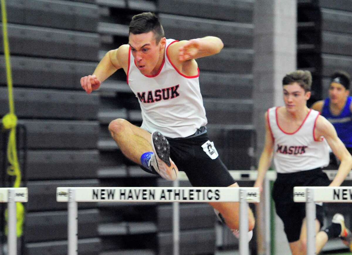 Masuk's Aidan McShane competes in the 55-meter hurdles during the SWC indoor track and field Championship in New Haven, Conn., on Feb. 2.