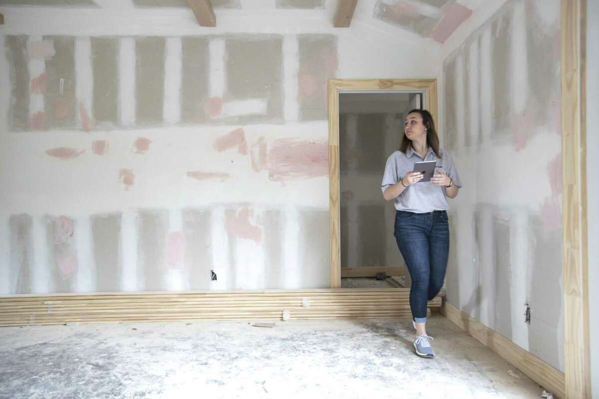 Bailee Wright, transaction coordinator for Entera, inspects and takes photos of progress on a home remodel for an institutional investor on Friday, March 8, 2019, in Houston.