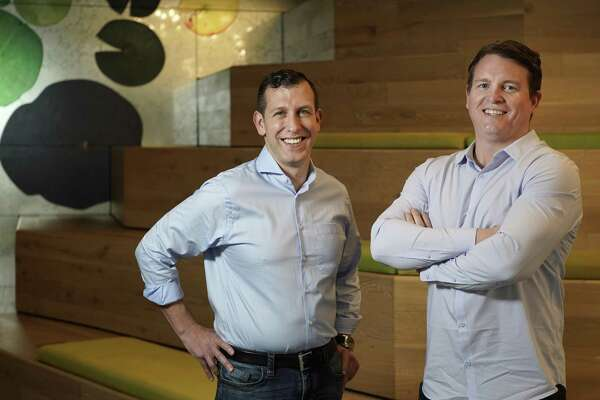 Entera founders Martin Kay, left, and Robert Salmons, right, are shown Thursday, March 14, 2019, in Houston.