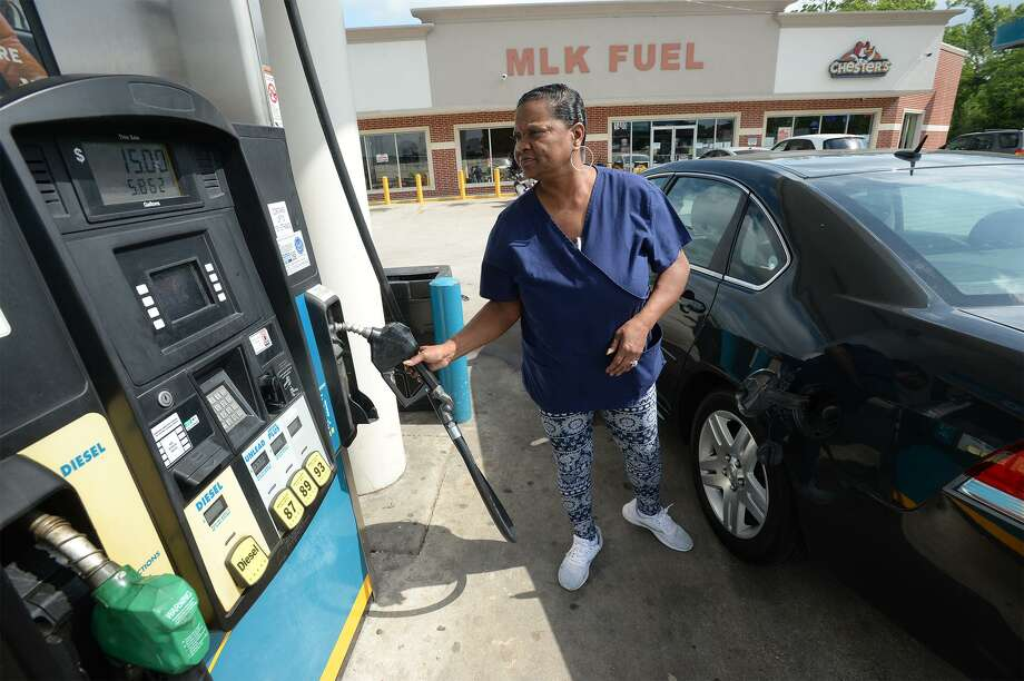 Beatrice Williams talks about gas prices while filling her tank at Racetrack on College Wednesday.  Photo taken Wednesday, 5/1/19 Photo: Guiseppe Barranco/The Enterprise, Photo Editor / Guiseppe Barranco ©