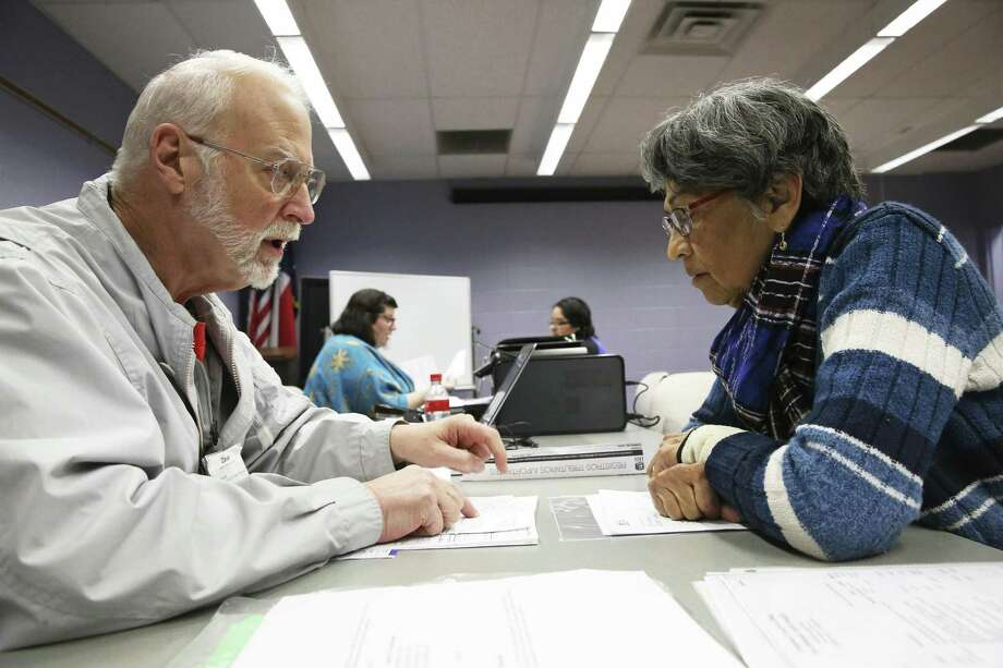 Twenty year veteran volunteer Dave Searcey goes over a return line by line with Christine Cyr as taxpayers use the Volunteer Income Tax Assistance program at the West Fall Library, March 6. A reader suggests creating a personalized tax program for taxpayers to decide where there money goes. Photo: Tom Reel /Staff Photographer / 2019 SAN ANTONIO EXPRESS-NEWS