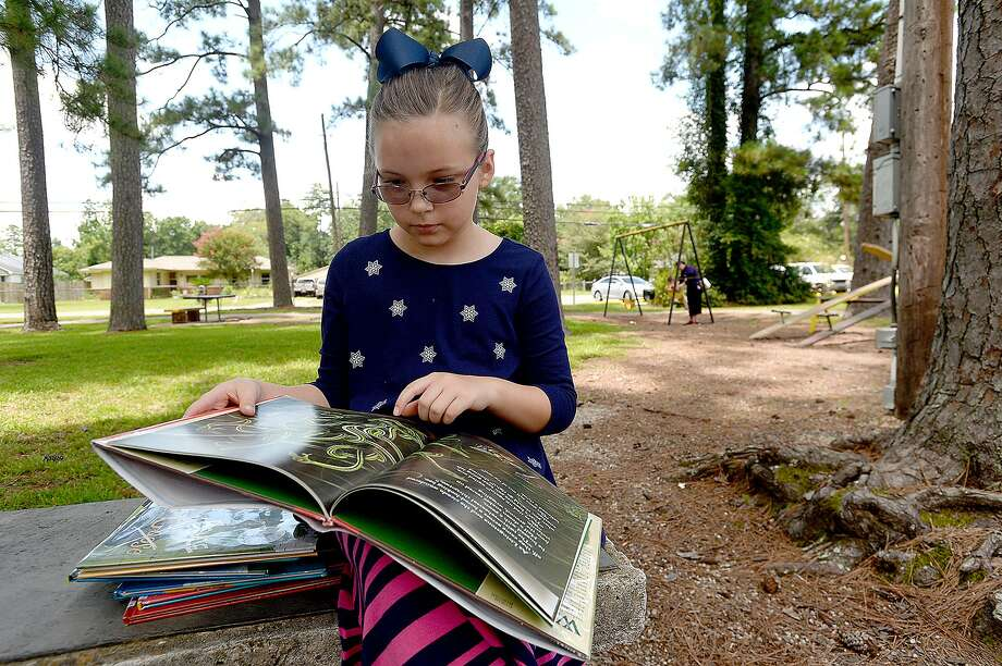 Students can't learn if they can't read. That's why Northside and North East AFT collaborated recently to bring free 80,000 books to area children. Photo: Beaumont Enterprise File Photo / BEN