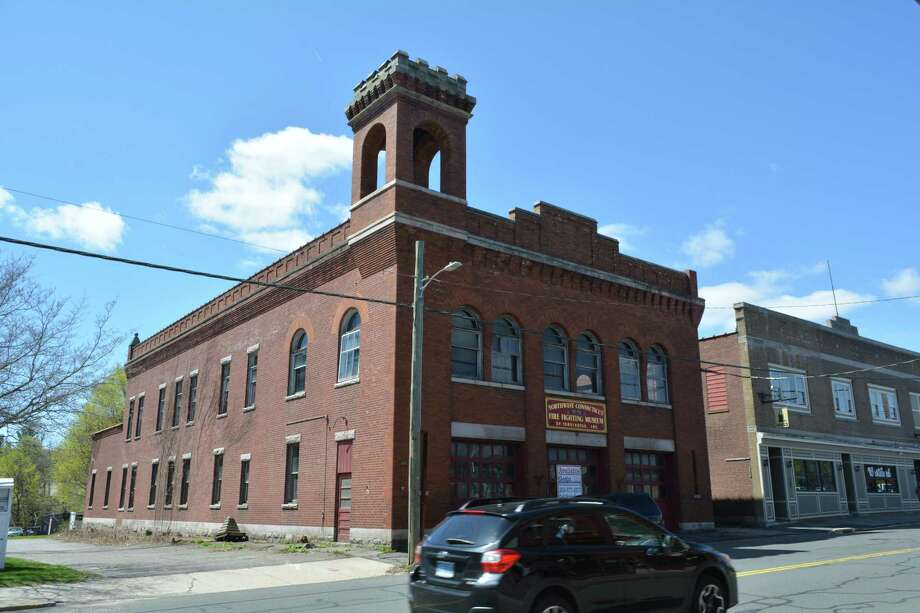 The two-story brick firehouse was built in 1901. The bell tower structure was flawed and couldn't support the bell. A new, stronger tower was built at the back of the building. Photo: Leslie Hutchison / Hearst Connecticut Media