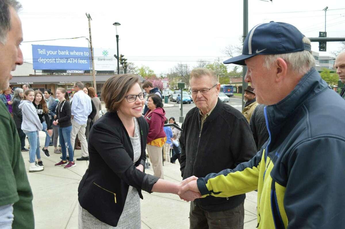 Hamden councilwoman Lauren Garrett, right, introduces herself to Jamie Viesselman, right, and Richard Pilchen, center, after announcing her run for mayor Wednesday May 1, 2019