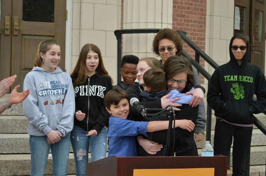 Hamden councilwoman Lauren Garrett embraces her three children after announcing her Democratic run for mayor  May 1, 2019. Photo: Clare Dignan / Hearst Connecticut Media