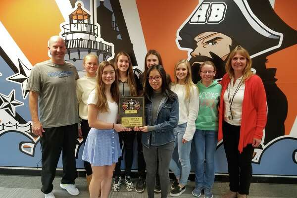 Members of the Harbor Beach girls track team pose with their first place trophy, following their victory, Tuesday, at the Ubly Invitational.