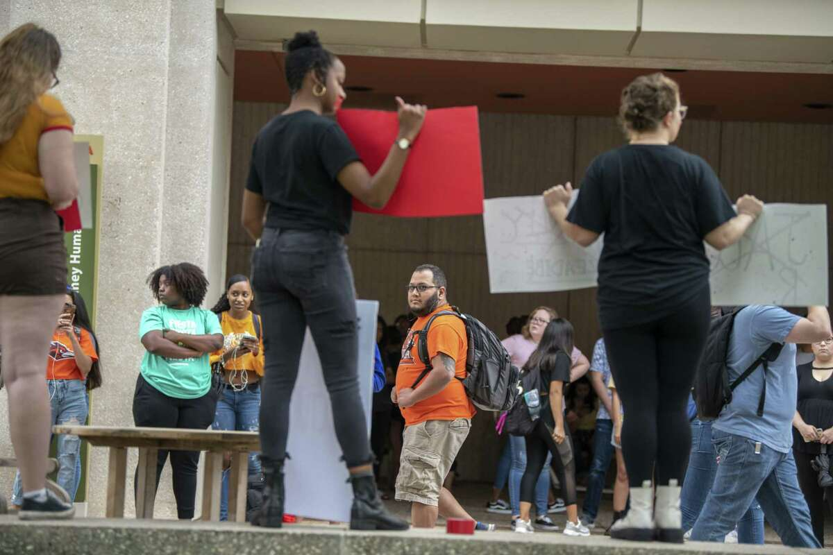 Students watch a campus demonstration by a group of UTSA students decrying rape culture as they name male students accused of sexual assault on Wednesday, May 1st, 2019.