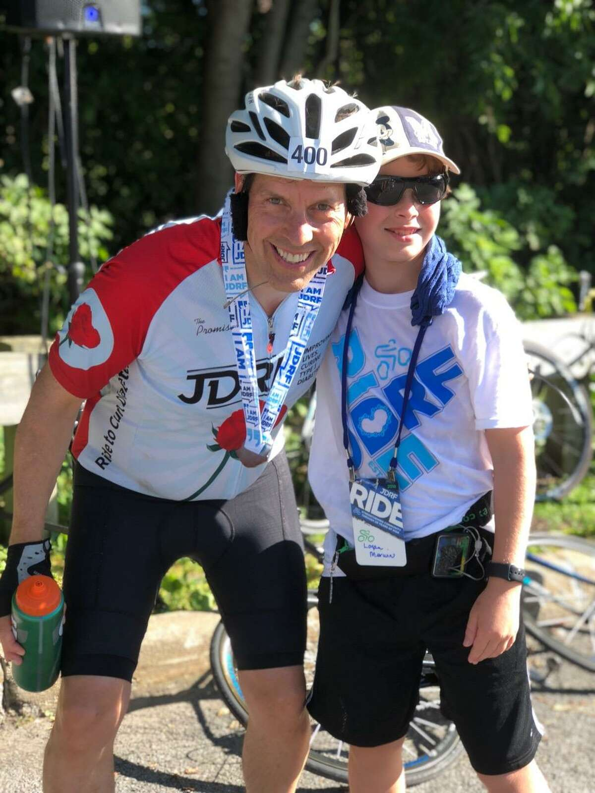 Logan Merwin, right, is shown with Juvenile Diabetes Research Foundation President and CEO Derek Rapp.