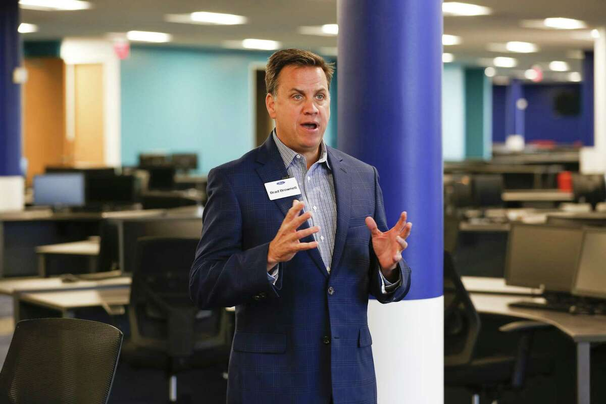 Brad Brownell, director of Ford's global contact centers, talks in their new call center Wednesday, May 1, 2019, in Houston.