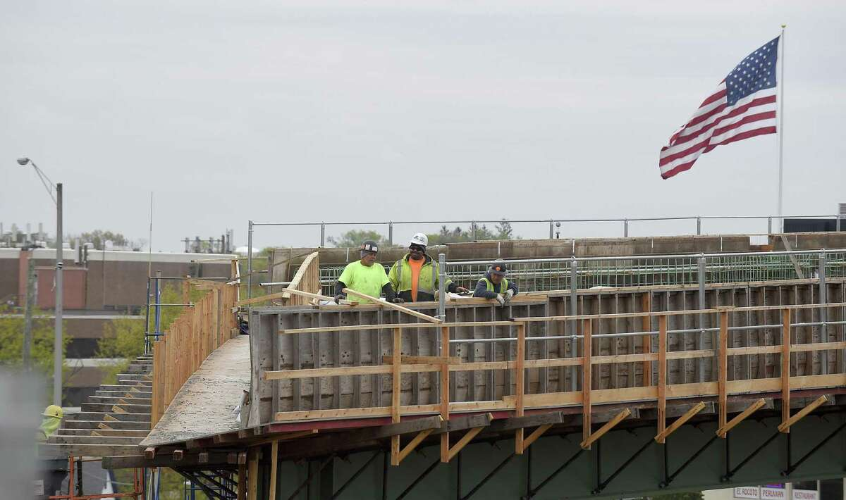 Using accelerated bridge construction technology, workers work on a section of a prefabricated bridge on Wednesday that is near completion as Connecticut DOT officials prepare final plans to roll it into place, replacing the 60-year-old Route 1 bridge deemed structurally deficient.