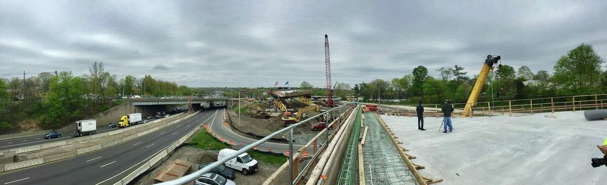 Using accelerated bridge construction technology a section of a prefabricated bridge, shown at right in a photograph taken on May 1, 2019, is near completion and Connecticut DOT officials are preparing to roll it into place, replacing the 60-year-old Route 1 bridge, at left, deemed structurally deficient. The project at Exit 9 on I-95 in Stamford, will take place over two weekends, closing Interstate 95 with traffic diverting onto existing on and off ramps and creating a traffic mess for travelers.