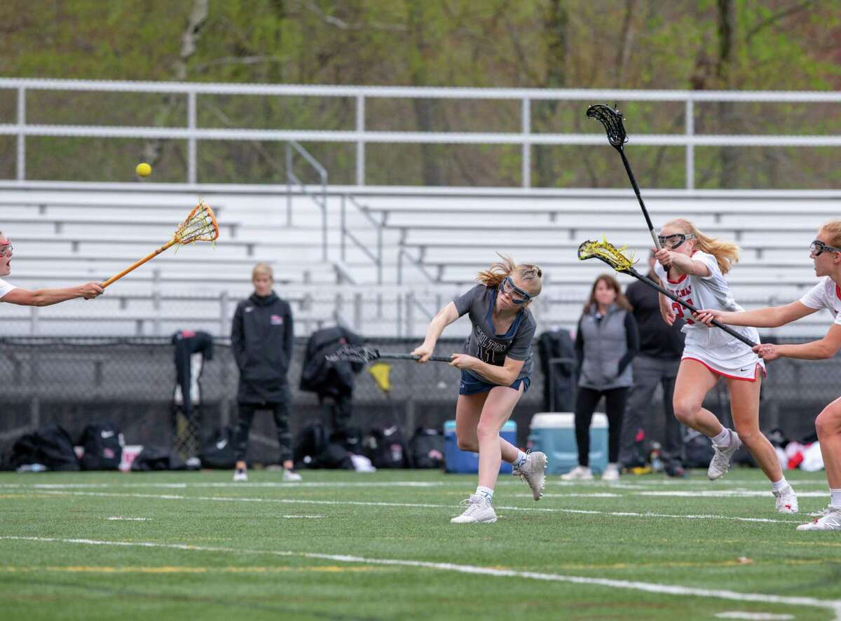 Olivia Gladstein of Wilton takes a shot in a girls lacrosse game Tuesday, April 20, 2019 in New Canaan.