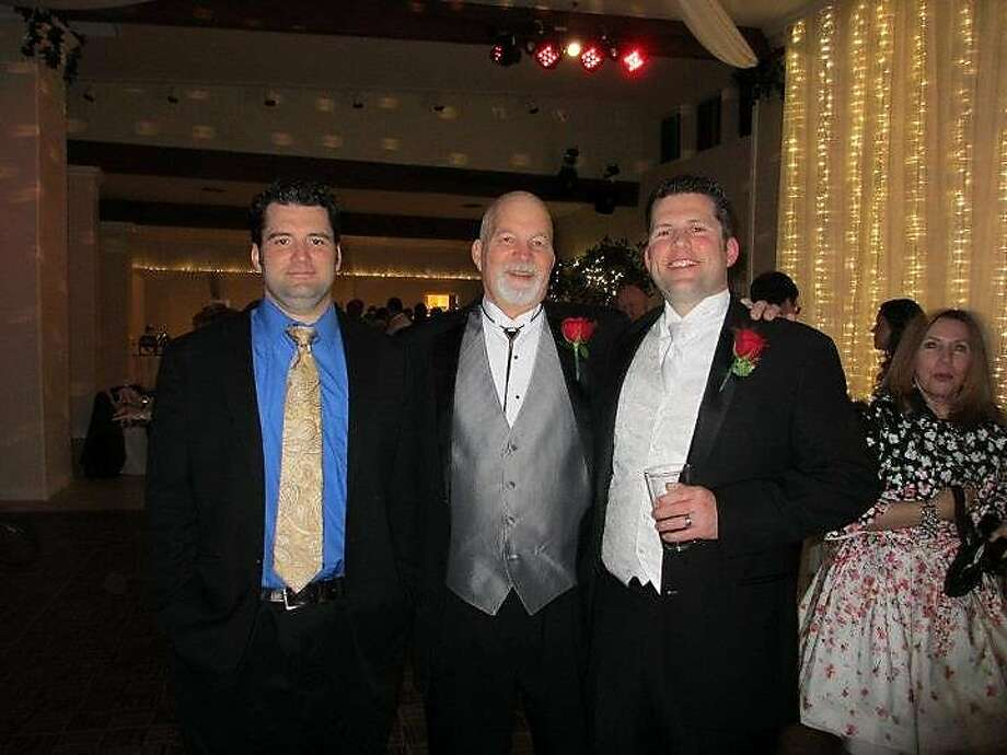 Tyson (left) and Baron attend Baron's wedding in 2012 with their father, Jim Feilzer. Photo: Courtesy Baron Feilzer 2012