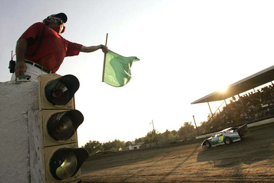 Jacksonville Speedway has been added to World Wide Technology Raceway's 2019 Track Invasion Tour. The Track Invasion Tour aggressively promotes WWT Raceway's NASCAR and IndyCar events at short tracks in the region. Above, Jacksonville flagger Randy Standridge signals the start of the first race. Photo: Robert Leistra | Journal-Courier File Photo