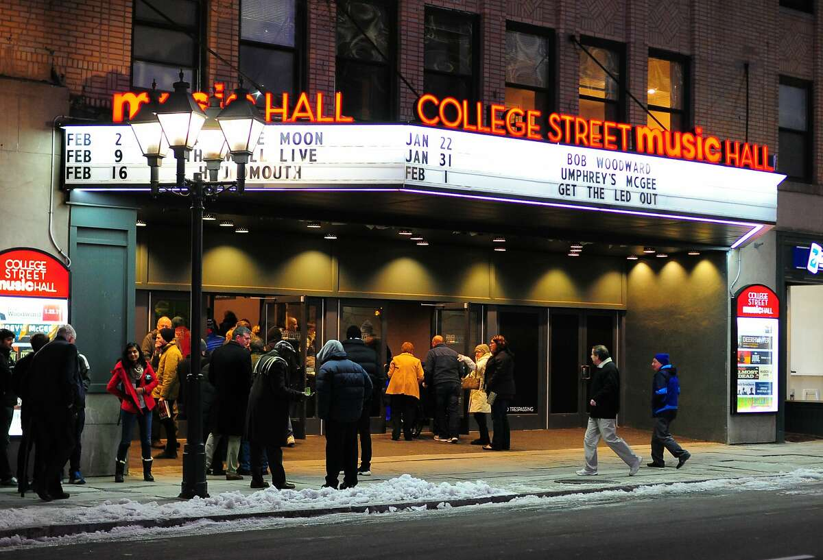 People arrive to hear from veteran journalist Bob Woodward at College Street Music Hall in downtown New Haven, Conn., on Tuesday Jan. 22, 2019.