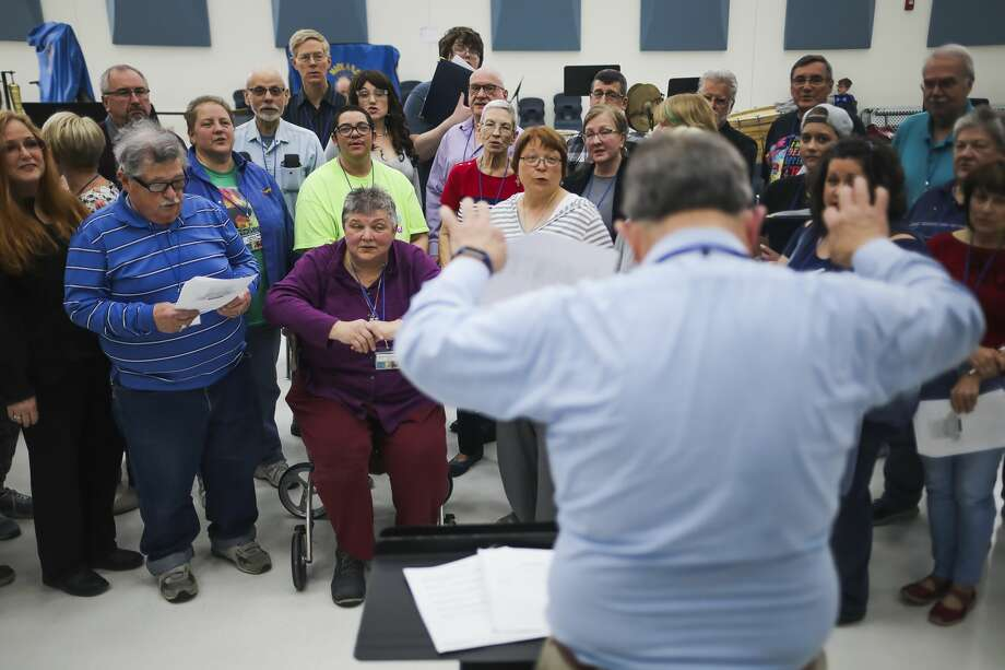 "Jim Hohmeyer, right, directs a group of singers from area churches and choirs on Sunday, April 7, 2019 at Midland High School during a rehearsal for an upcoming concert called ""Brave New Voices."" (Katy Kildee/kkildee@mdn.net) Photo: (Katy Kildee/kkildee@mdn.net)"