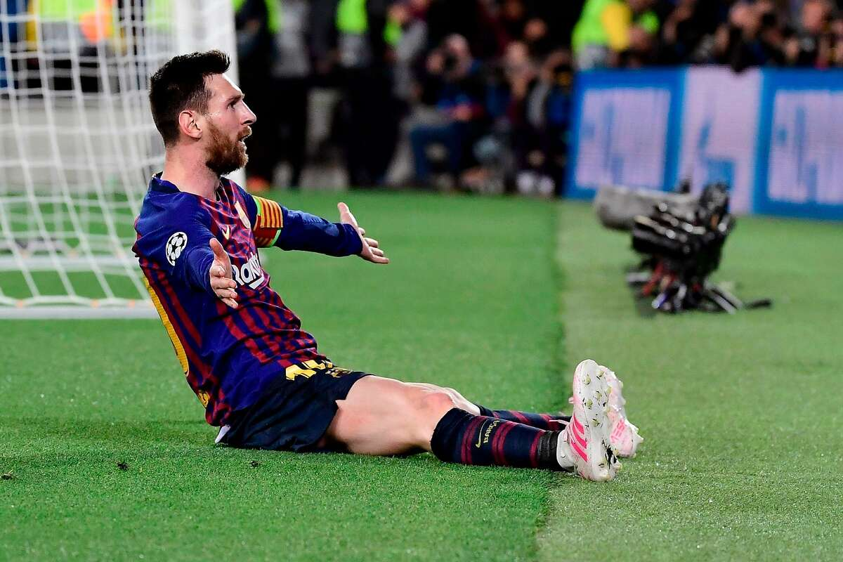 Barcelona's Argentinian forward Lionel Messi celebrates after scoring his team's third goal during the UEFA Champions League semi-final first leg football match between Barcelona and Liverpool at the Camp Nou Stadium in Barcelona on May 1, 2019. (Photo by JAVIER SORIANO / AFP)JAVIER SORIANO/AFP/Getty Images