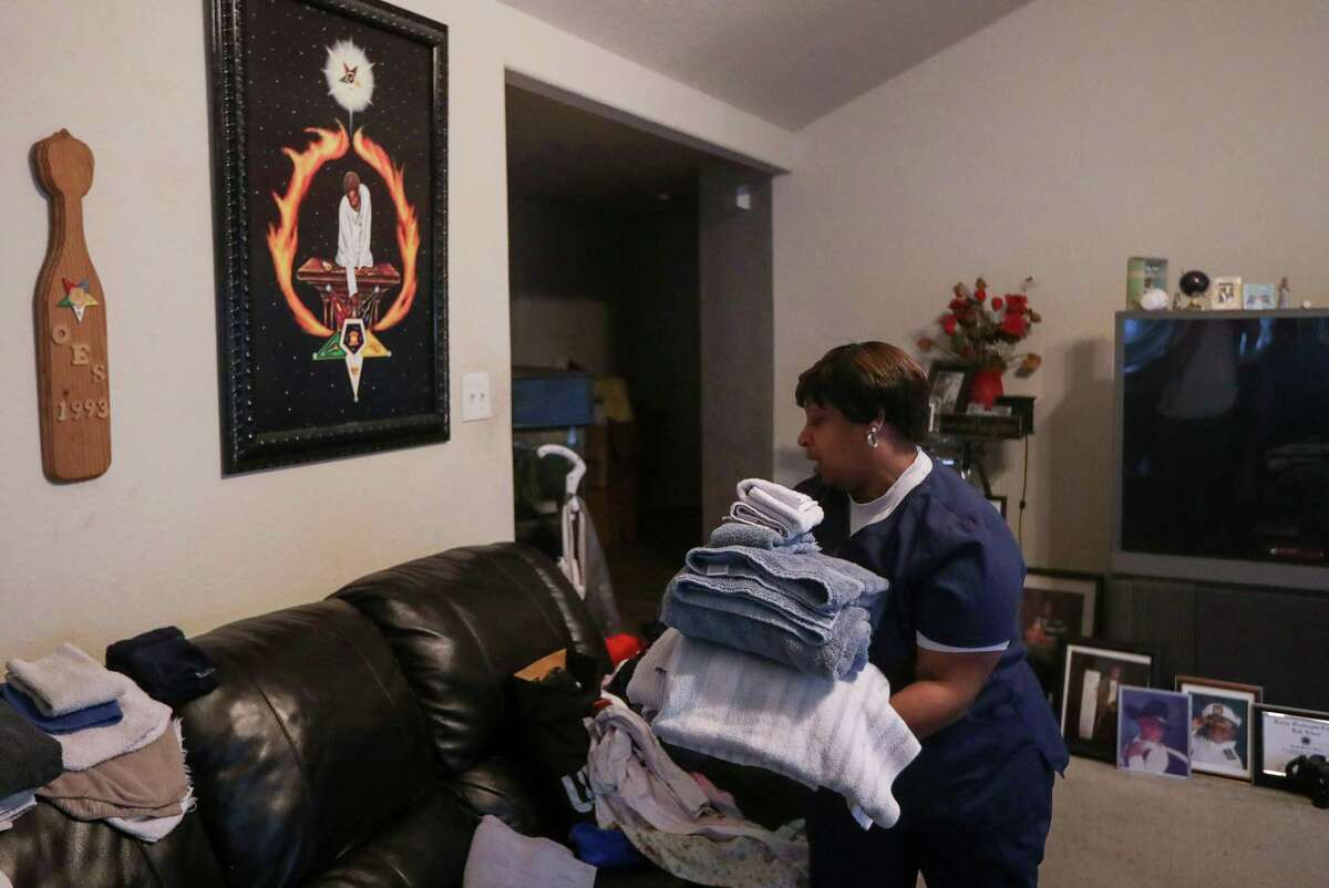 Yalanda White does chores after getting home from work on Tuesday, April 30, 2019, in Houston.
