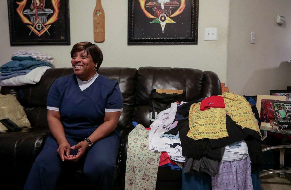 Yalanda White takes a break from chores after getting home from work on Tuesday, April 30, 2019, in Houston. She left a job at a hospital to work in a school district because she wanted to spend more time with her family.