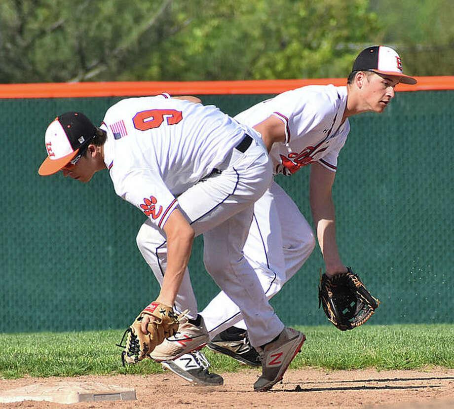 Edwardsville second baseman Logan Cromer fields a ground ball in front of shortstop Josh Ohl in the first inning against Belleville West. Photo: Matt Kamp/The Intelligencer