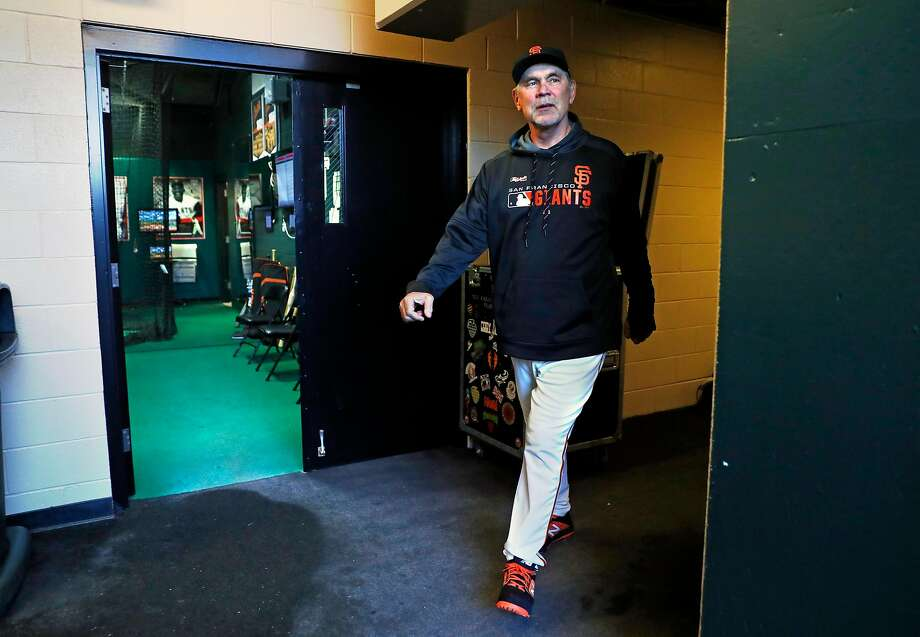 Manager Bruce Bochy walks from the Giants' clubhouse to the dugout for his media availability before a game against the Dodgers. Photo: Scott Strazzante / The Chronicle