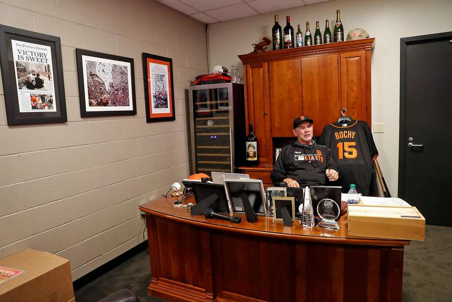 San Francisco Giants manager Bruce Bochy spends time in his memento-filled office before playing the Los Angeles Dodgers at Oracle Park in San Francisco on April 29. Photo: Scott Strazzante / The Chronicle
