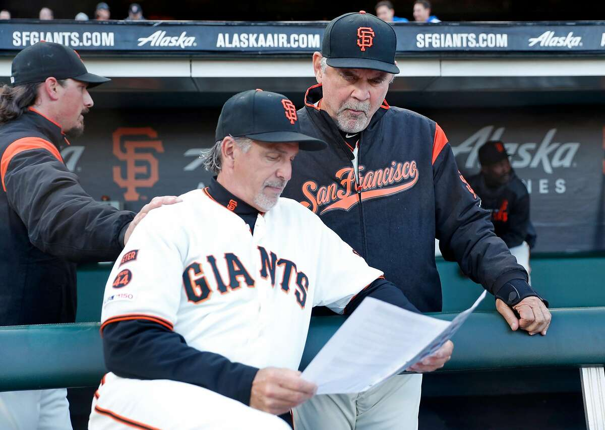 San Francisco Giants' manager Bruce Bochy and bench coach Ron Wotus strategize before 3-2 win over Los Angeles Dodgers during MLB game at Oracle Park in San Francisco, Calif., on Monday, April 29, 2019.