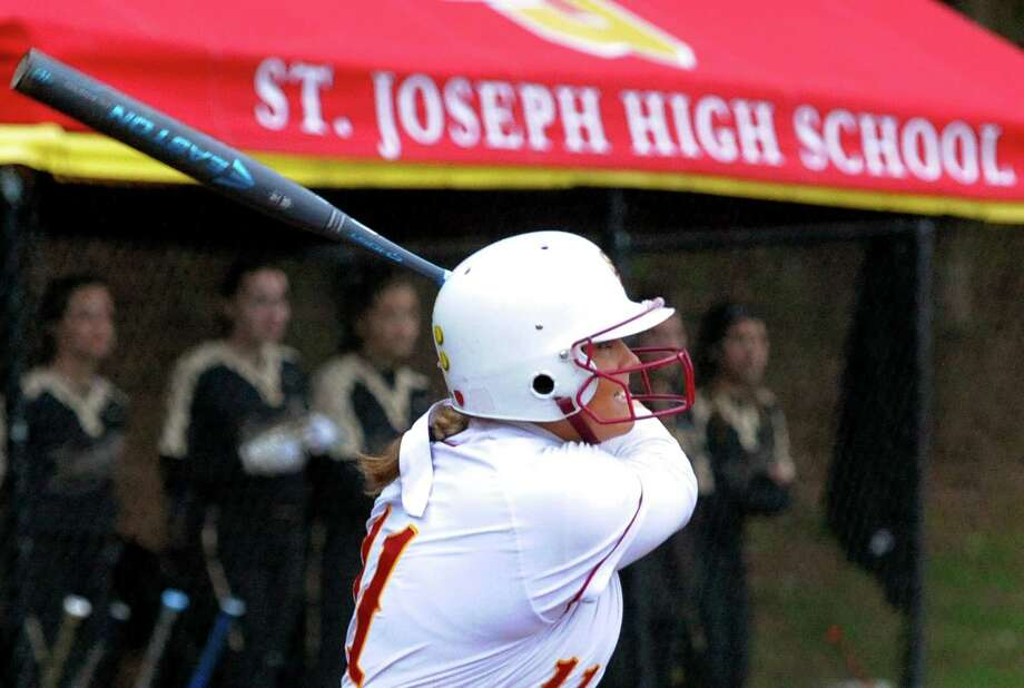 St. Joseph's Charlee Horton hits a walk-off home run to beat Trumbull 2-1 in the eigth inning on Wednesday in Trumbull. Photo: Christian Abraham / Hearst Connecticut Media / Connecticut Post