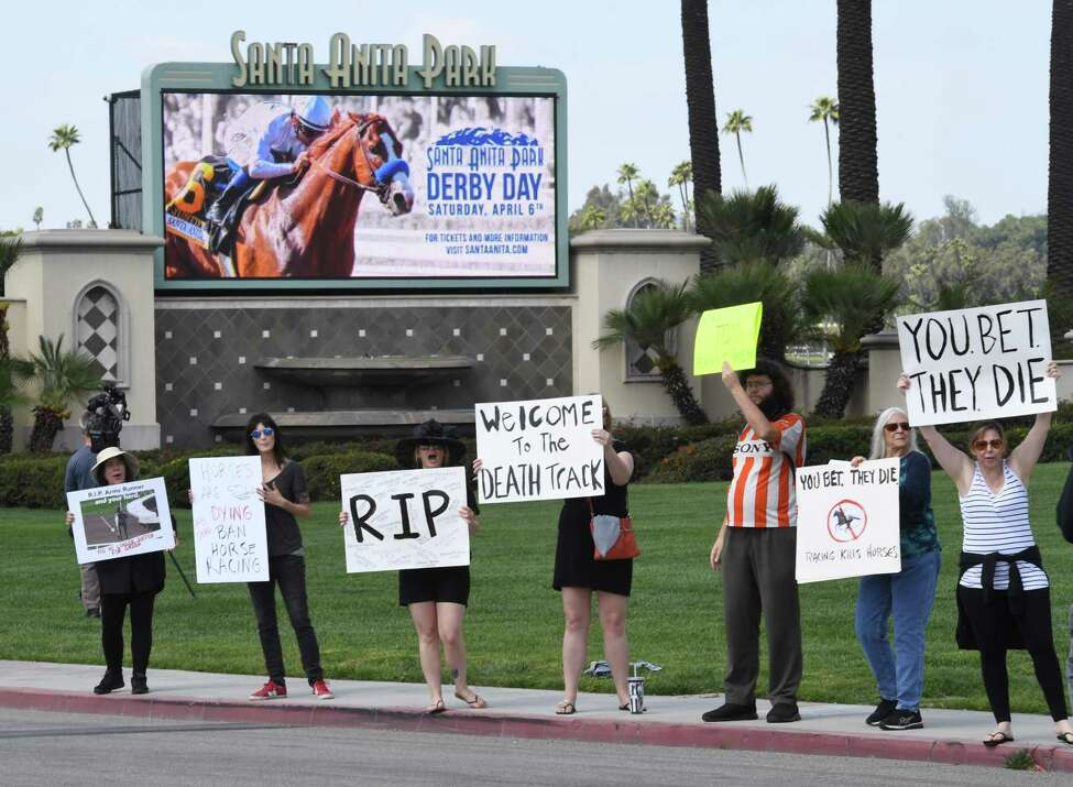 Animal-rights advocates protest beside the entrance gate, the deaths of 23 racehorses in the first three months of this year at the Santa Anita Racetrack in Arcadia,, California, on April 6, 2019. - Santa Anita Park averaged more than 55 horse deaths per year from 2008-18, according to data from the California Horse Racing Board, a total of 553 deaths in all, but this year's major rise in deaths is under investigation. (Photo by Mark RALSTON / AFP)MARK RALSTON/AFP/Getty Images