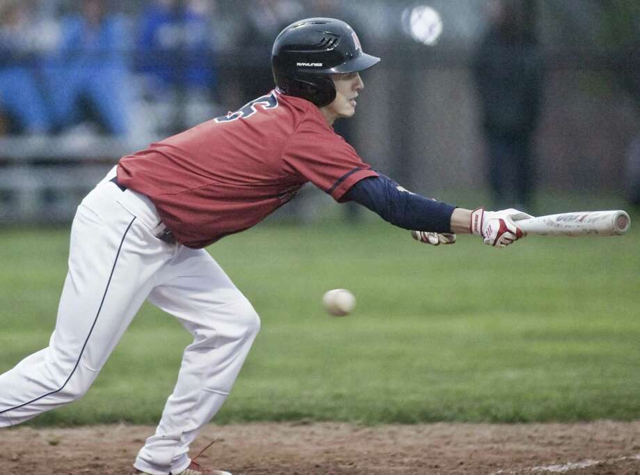 New Fairfield High School's Ryan Grimaldi tries to put down a bunt in a game against Newtown High School, played at Newtown. Wednesday, May 1, 2019 Photo: Scott Mullin / For Hearst Connecticut Media / The News-Times Freelance