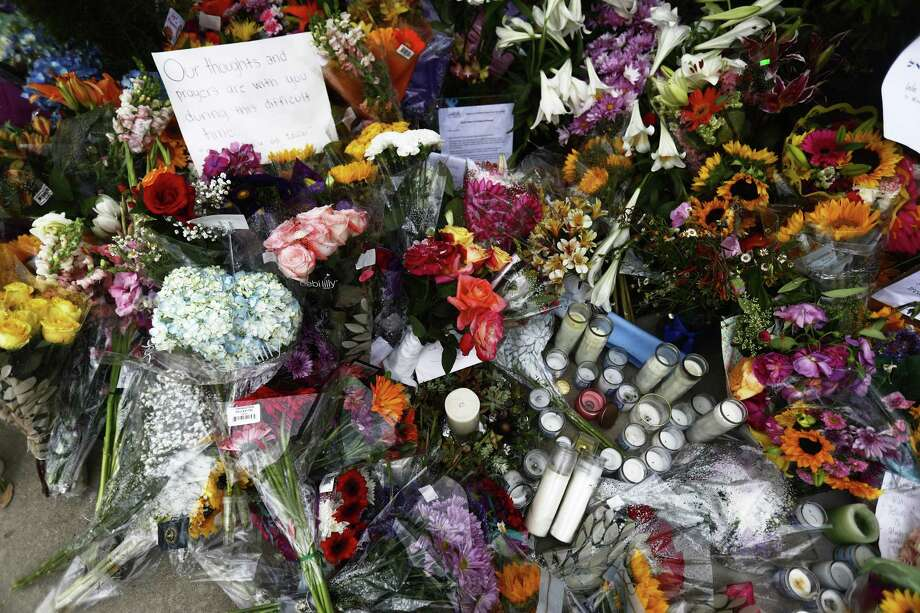 POWAY, CALIFORNIA - APRIL 29: Flowers, candles and mementos are left outside the funeral for Lori Gilbert Kaye, who was killed inside the Chabad of Poway synagogue by a gunman who opened fire during services, on April 29, 2019 in Poway, California. The suspect will be arraigned tomorrow. (Photo by Mario Tama/Getty Images) Photo: Mario Tama / Getty Images / 2019 Getty Images