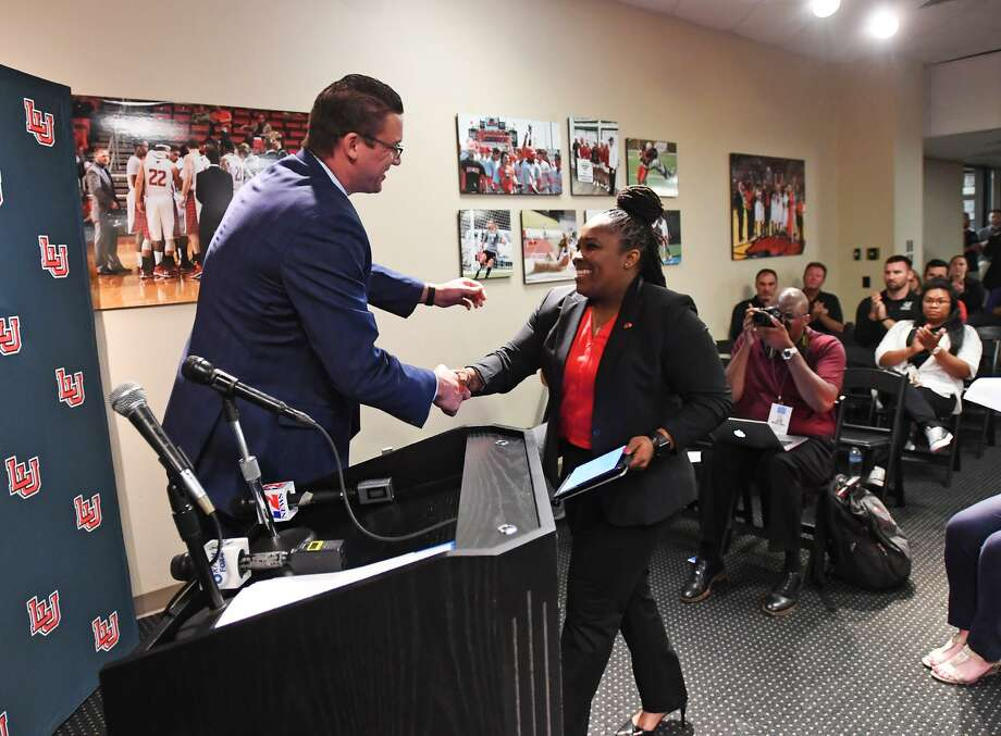 Aqua Franklin was named Lamar's new women's basketball coach during a conference on Wednesday. Franklin shakes hands with school athletic director Marco Born during the event. Photo taken Wednesday, 5/1/19 Photo: Guiseppe Barranco/The Enterprise, Photo Editor / Guiseppe Barranco ©