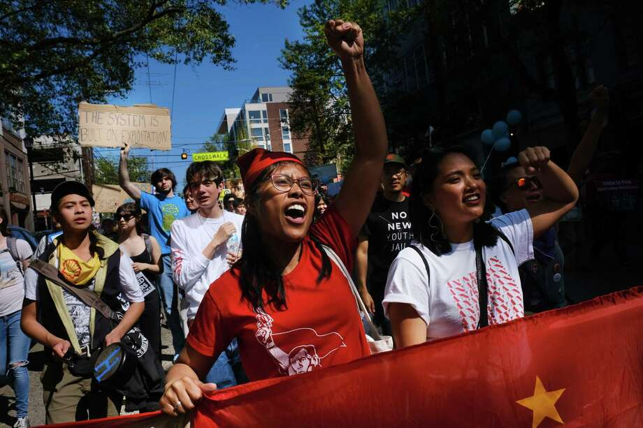 Laurie Rocello Torres, center, marches with Migrante Seattle during Seattle's 20th annual Immigrants' and Workers' Rights May Day demonstration, Wednesday, May 1, 2019.  Over 1,000 people marched from Judkins Park to the U.S. District Courhouse building downtown, making stops at the Chateau Apartments, Whole Foods and the Amazon Spheres along the way for short rallies. Photo: Genna Martin, SEATTLEPI / GENNA MARTIN