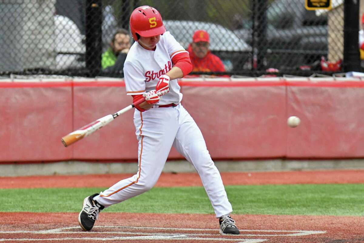 Anthony Torreso (16) of the Stratford Red Devils makes contact and drives in a run during a game against the Immaculate Mustangs on Wednesday May 1, 2019 at Penders Field in Stratford, Connecticut.