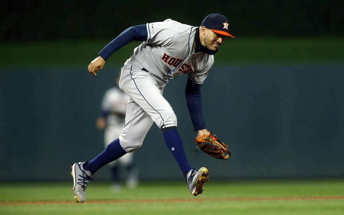 Houston Astros shortstop Carlos Correa fields a grounder and throws out Minnesota Twins' Jonathan Schoop during the seventh inning of a baseball game Wednesday, May 1, 2019, in Minneapolis. The Twins won 6-2. (AP Photo/Jim Mone)