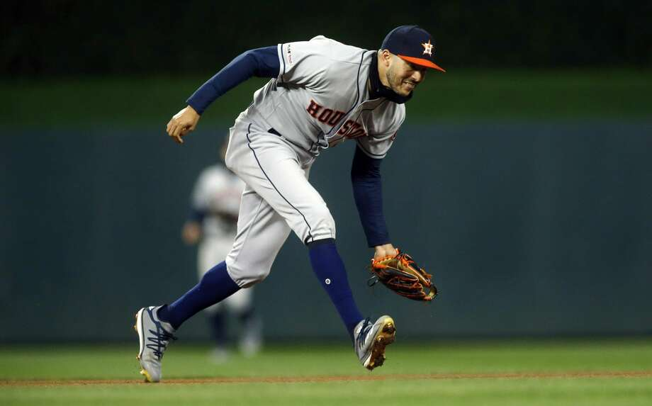 Houston Astros shortstop Carlos Correa fields a grounder and throws out Minnesota Twins' Jonathan Schoop during the seventh inning of a baseball game Wednesday, May 1, 2019, in Minneapolis. The Twins won 6-2. (AP Photo/Jim Mone) Photo: Jim Mone/Associated Press