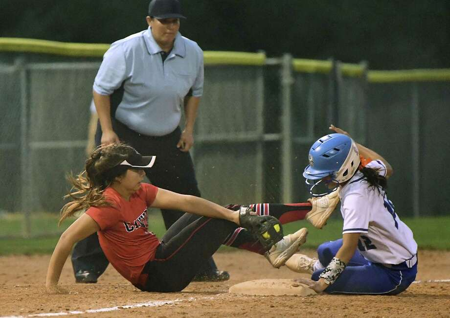 Sydney Belvin of New Braunfels Canyon is unable to tag Sarah Montes of MacArthur at third base during Game 1 of the UIL Class 6A second-round high school softball playoff series on Wednesday May 1, 2019. Photo: Billy Calzada, Staff / Staff Photographer / San Antonio Express-News