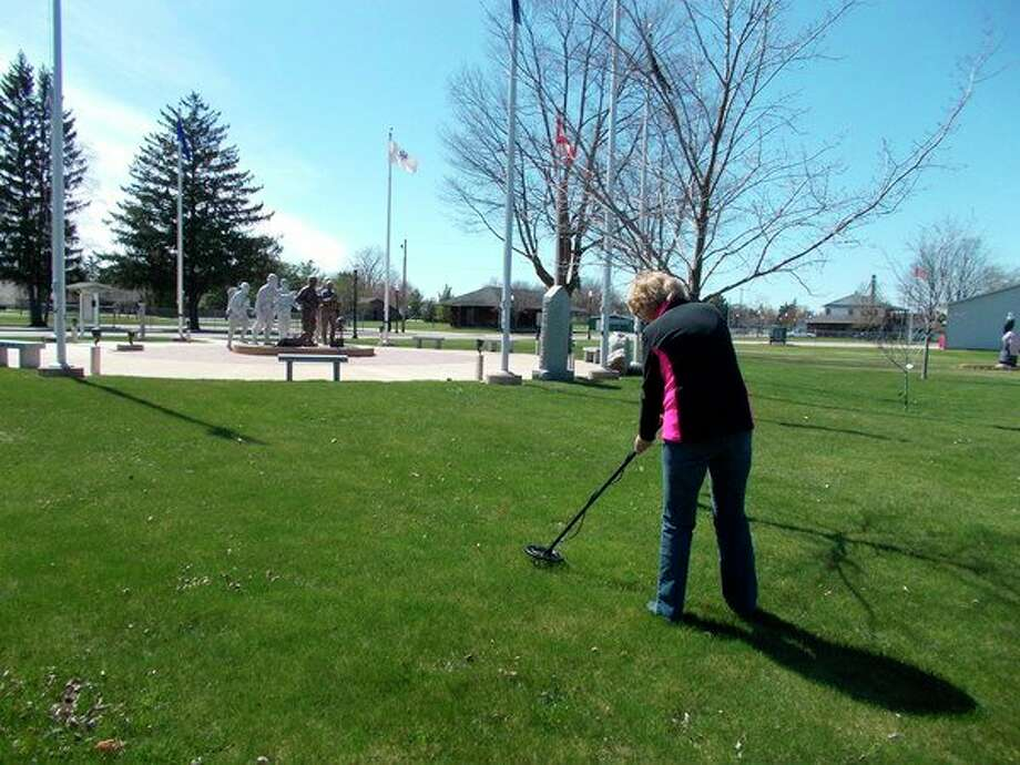 Sandra Galgoci of Coleman uses the metal detector that is available for checkout at the Coleman Area Library. (Photo provided)
