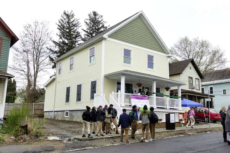 People gather for an event outside of a new net-zero home at 101 Prospect Street, that was built by YouthBuild Schenectady students in partnership with Saint-Gobain on Wednesday, May 1, 2019, in Schenectady, N.Y.   (Paul Buckowski/Times Union) Photo: Paul Buckowski, Albany Times Union / (Paul Buckowski/Times Union)