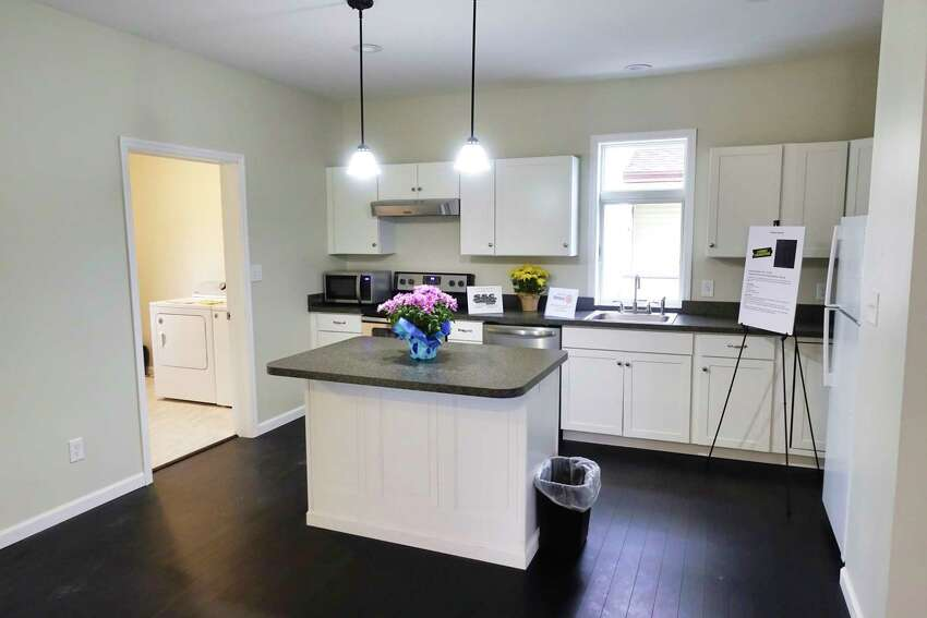 A view of the kitchen inside the newly built net-zero home at 101 Prospect Street on Wednesday, May 1, 2019, in Schenectady, N.Y. The home was built by YouthBuild Schenectady students in partnership with Saint-Gobain. (Paul Buckowski/Times Union)