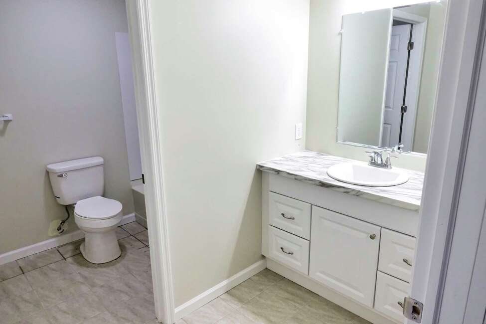 A view of one of the bathrooms inside the newly built net-zero home at 101 Prospect Street on Wednesday, May 1, 2019, in Schenectady, N.Y. The home was built by YouthBuild Schenectady students in partnership with Saint-Gobain. (Paul Buckowski/Times Union)
